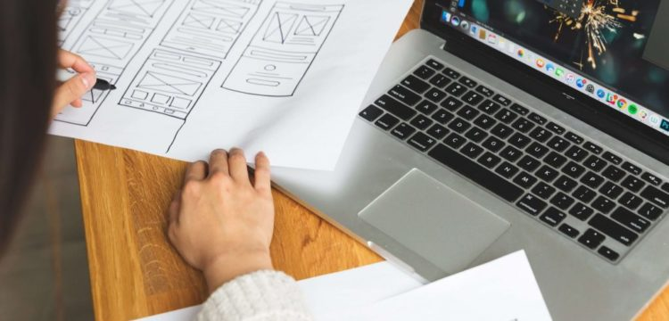 female-designer-reviewing-wireframes